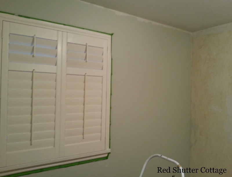 Here is an image showing the Mountain Haze by Behr paint color on the wall. How I Created a Home Office from a Bedroom.