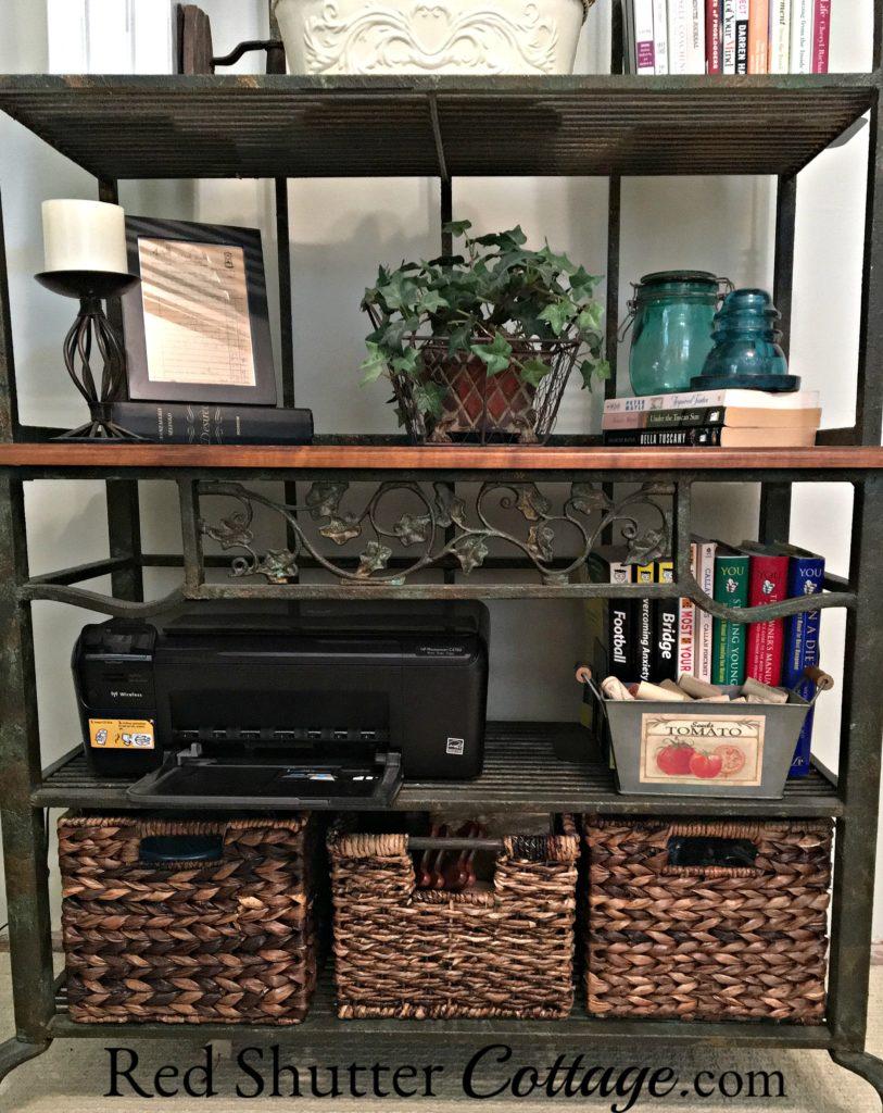 Bottom shelves of baker's rack showing inkjet printer. www.redshuttercottage.com