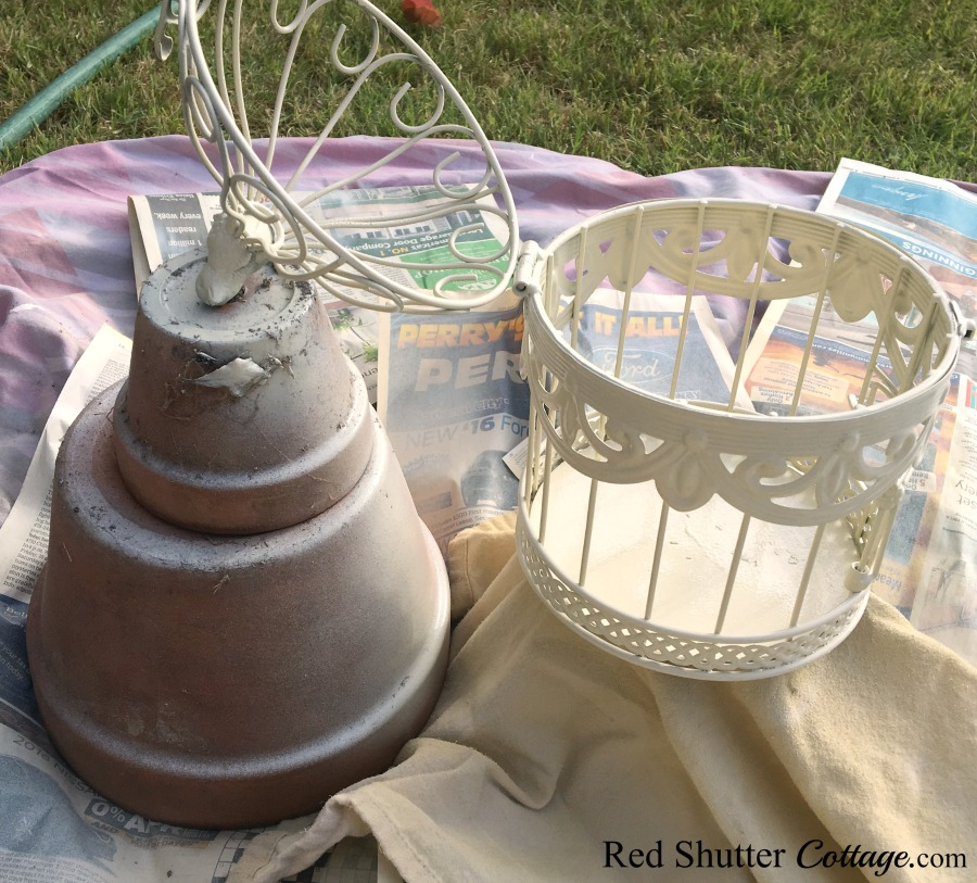 Painting the birdcage using pots. www.redshuttercottage.com