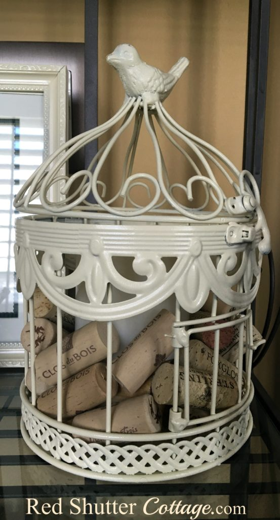 Birdcage sitting on Baker's Rack. www.redshuttercottage.com