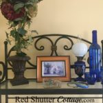 This is the top shelf of the bakers rack in bedroom. www.redshuttercottage.com