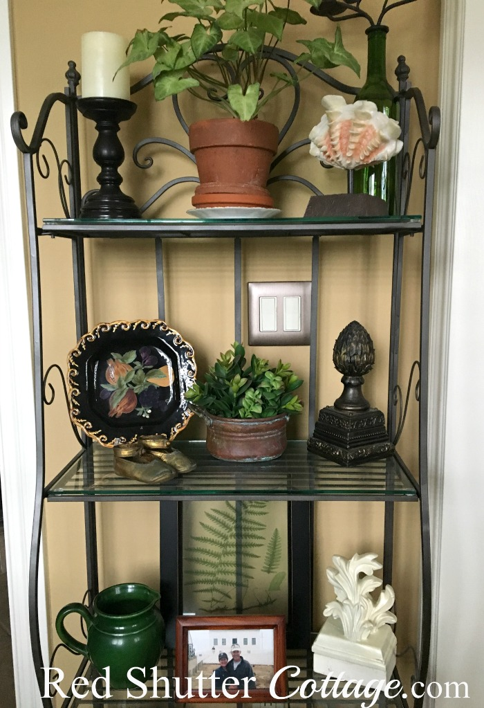 These are the top 3 shelves of the baker's rack in the nook. www.redshuttercottage.com