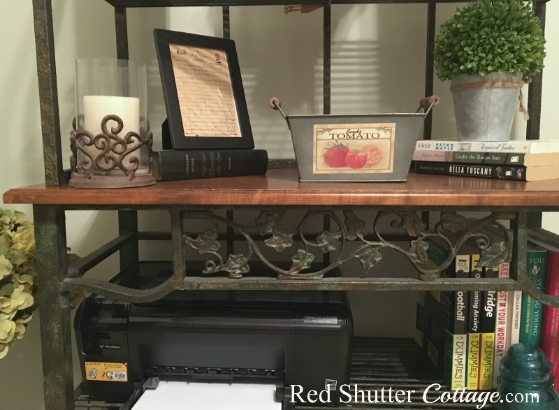 Close up of shelves of baker's rack in office showing ivy grid and printer. www.redshuttercottage.com
