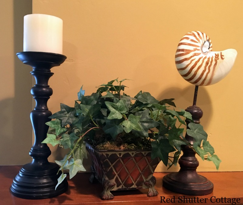 Summer mantel with candle, ivy topiary and shell. How to Decorate a Summer Mantel.