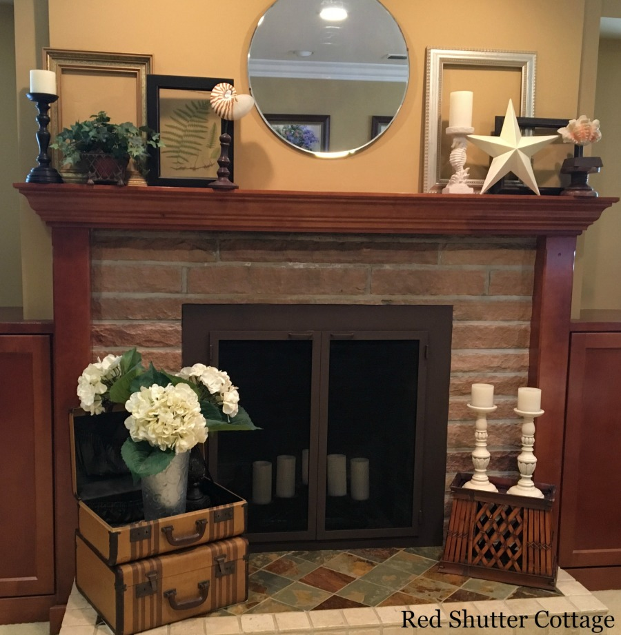 Summer mantel complete view with candles on hearth. How to Decorate a Summer Mantel.