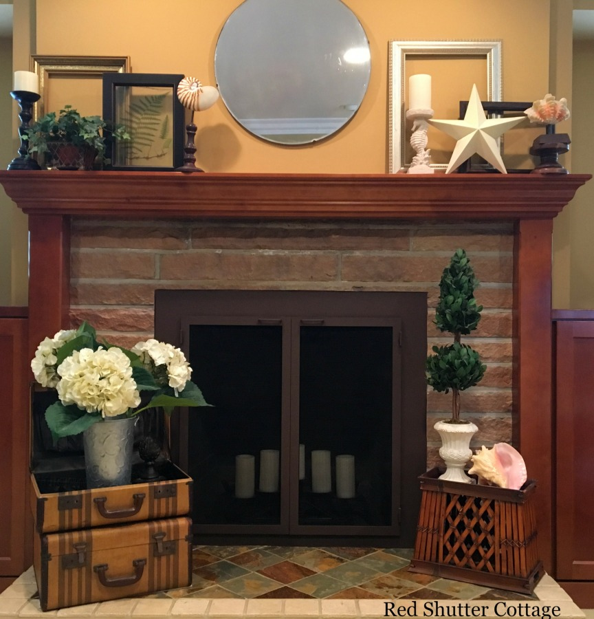 Summer mantel complete view with large topiary on hearth. How to Decorate a Summer Mantel.