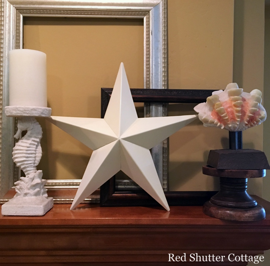 Summer mantel with frames behind star and shell. How to Decorate a Summer Mantel.