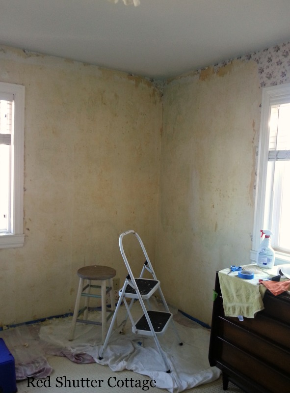 Taking down the wallpaper from the bedroom walls. How I Created a Home Office from a Bedroom.