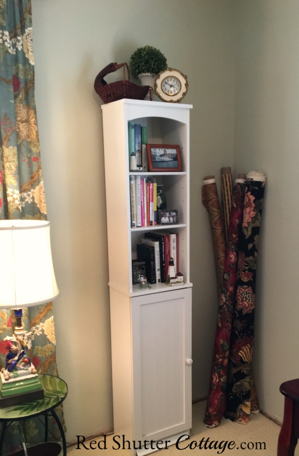 A small white storage unit holding books and tchotchkes in my Home Office. www.redshuttercottage.com