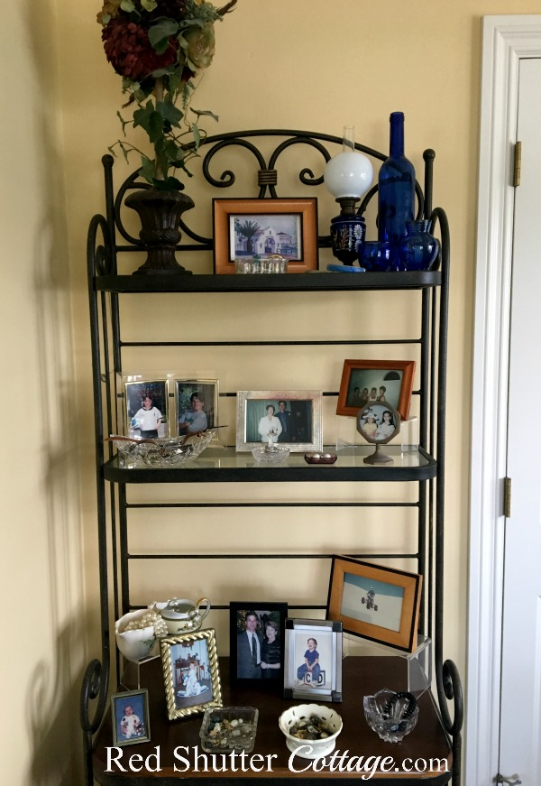 This is the top 3 shelves of the baker's rack in bedroom. www.redshuttercottage.com