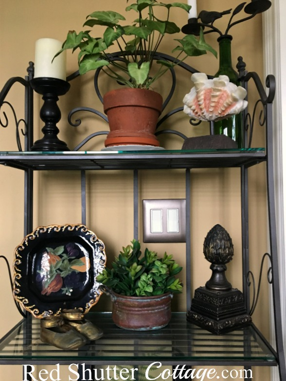 These are the top 2 shelves of the baker's rack in the nook. www.redshuttercottage.com