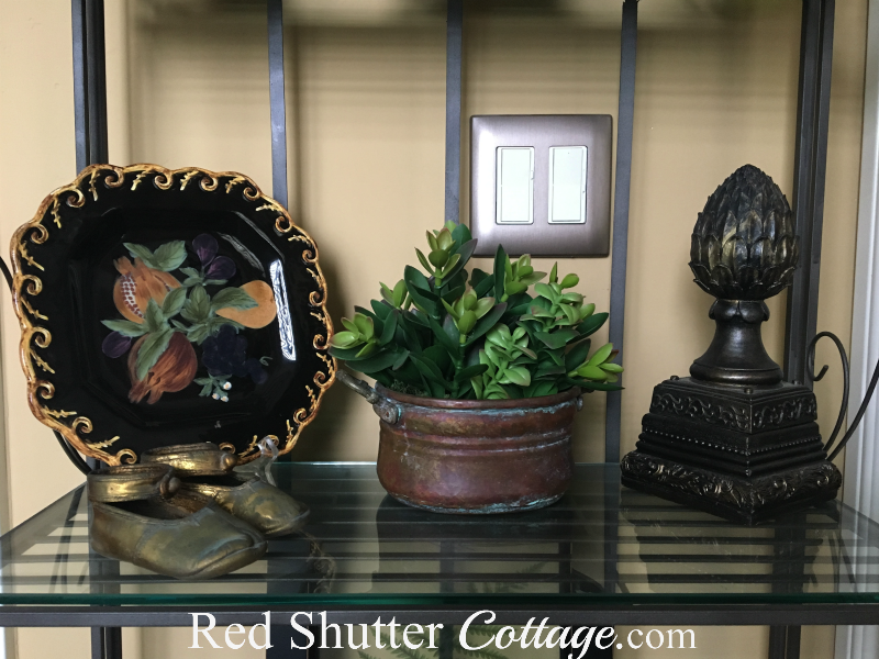 This is the shelf showing a plate and succulent in baker's rack in nook. www.redshuttercottage.com