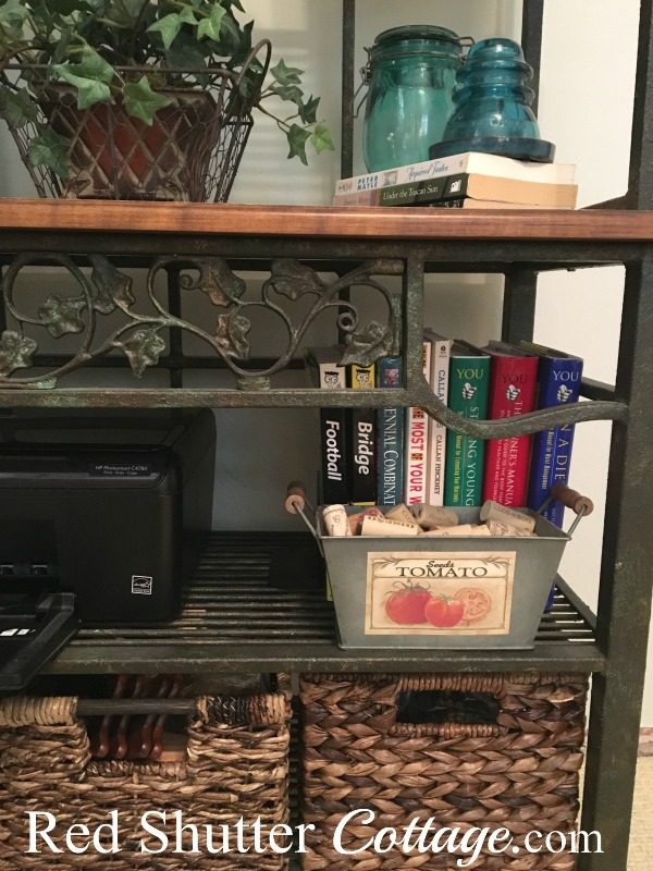 Close up of 2 shelves of baker's rack in office. www.redshuttercottage.com