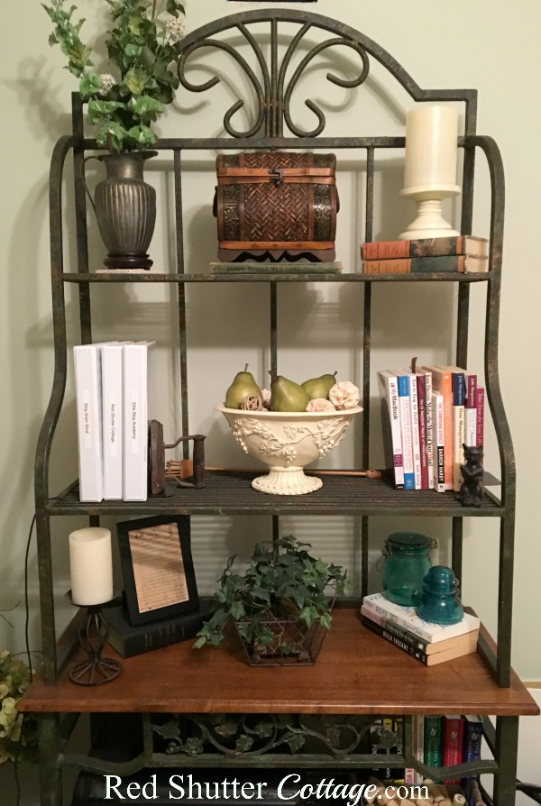 Full view of baker's rack with rattan chest and bowl of pears. www.redshuttercottage.com