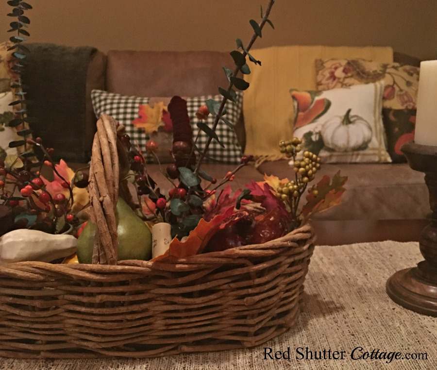 Fall coffee table with basket of harvest fruit. www.redshuttercottage.com