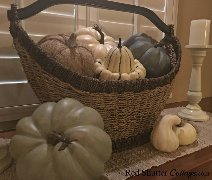 Fall display of neutral pumpkins in basket. www.redshuttercottage.com