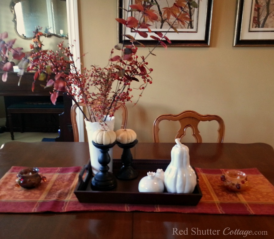 Our fall dining room table from 2015 with vase and ceramic fruit. www.redshuttercottage.com