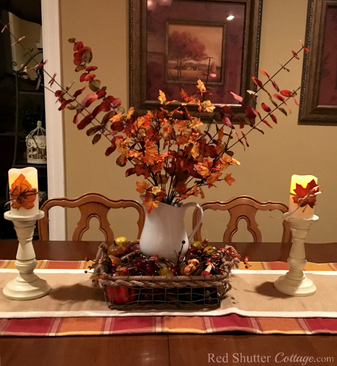 Our fall 2016 dining table with eucalyptus. and basket of fall fruit. www.redshuttercottage.com