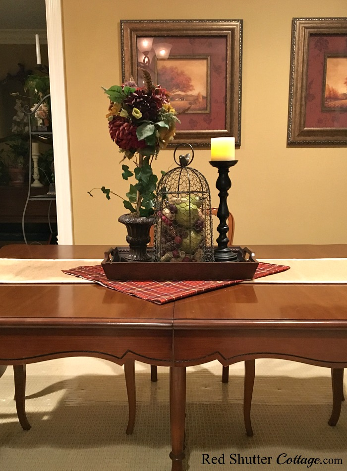 A front view of our fall 2017 dining table with plaid runner and cloche. www.redshuttercottage.com