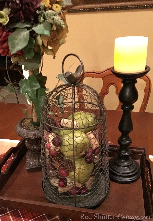 Our Fall 2017 dining table vignette showing pears, pine cones, berries and wine corks corralled in a cloche. www.redshuttercottage.com