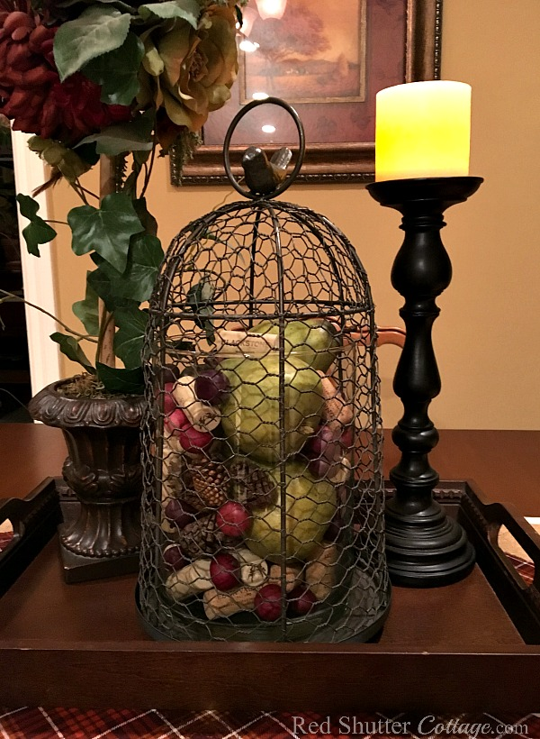 Our Fall 2017 dining room table with close up of cloche filled with berries, wine corks pine cones and pears. www.redshuttercottage.com