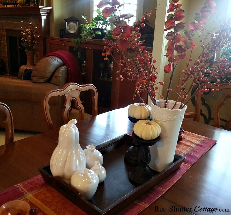 Our fall dining table from 2015 with eucalyptus, bitters, and baby boo pumpkins. www.redshuttercottage.com