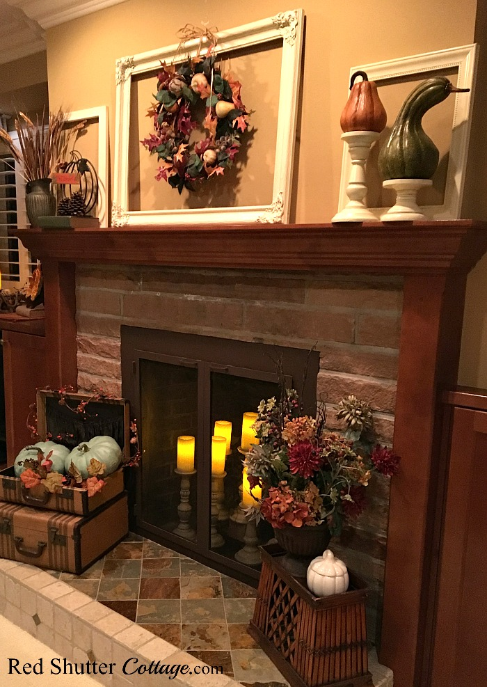 Our Fall 2017 mantel display with wreath, candles a variety of pumpkins. www.redshuttercottage.com
