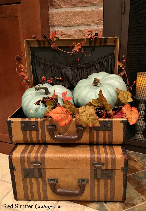 A pair of suitcases holding 2 teal pumpkins for Fall 2017. www.redshuttercottage.com
