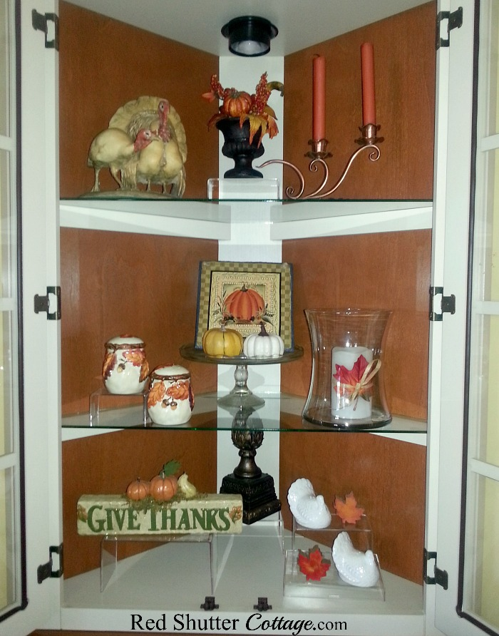 A close-up view of our 2016 Thanksgiving hutch showing vintage ceramic turkeys, and a copper candleholder. www.redshuttercottage.com