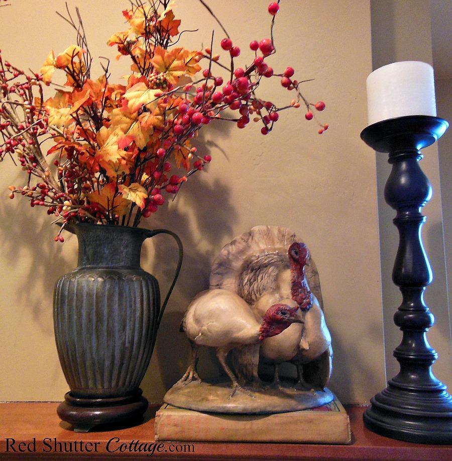 A pair of vintage ceramic turkeys on the mantel. www.redshuttercottage.com