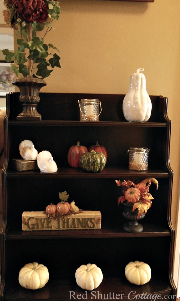Our 2016 Thanksgiving display shelf showing a 'Give Thanks' sign and white ceramic salt~n~pepper shakers. www.redshuttercottage.com