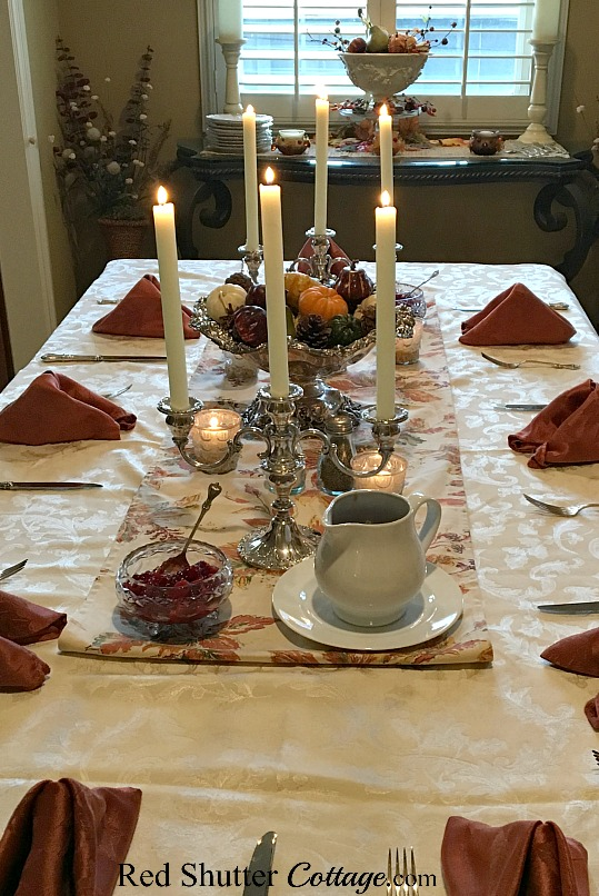 A long view of our 2016 Thanksgiving table including the gravy pitcher and cranberry sauce. www.redshuttercottage.com