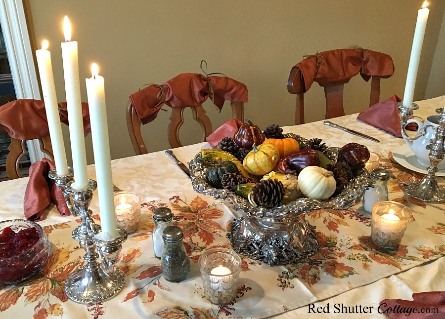 Our 2016 Thanksgiving table set with family silver, harvest fruit and candles. www.redshuttercottage.com