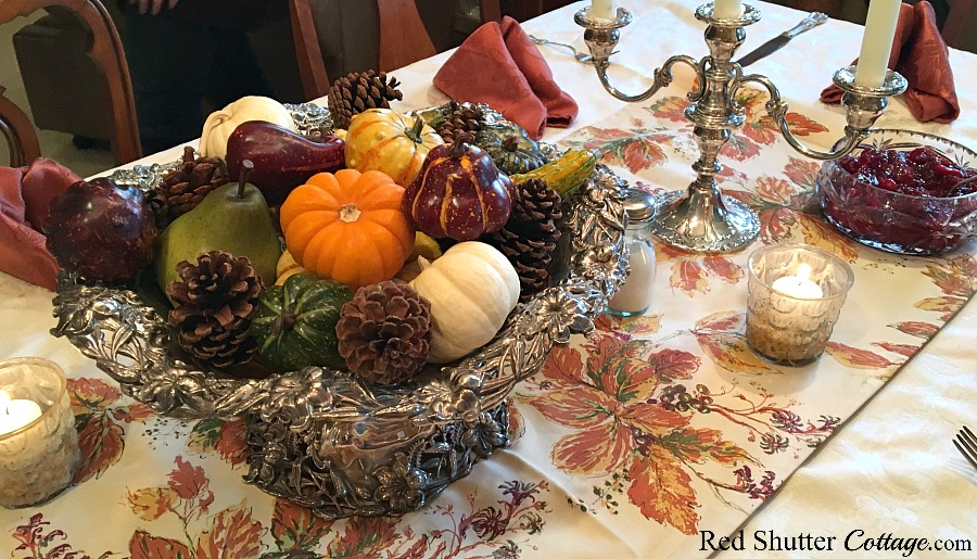 A close-up view of our 2016 Thanksgiving table including inherited family silver, a fall runner, and cranberry sauce. www.redshuttercottage.com