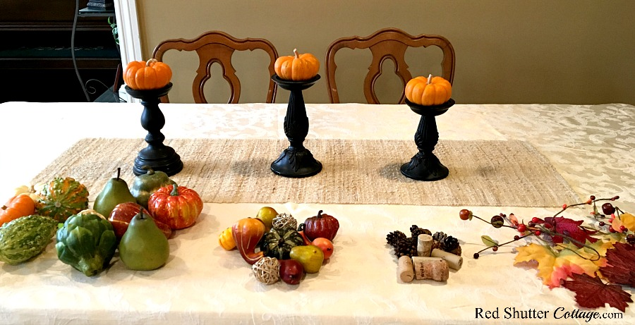 Pumpkins on candleholders for Thanksgiving table tutorial. www.redshuttercottage.com