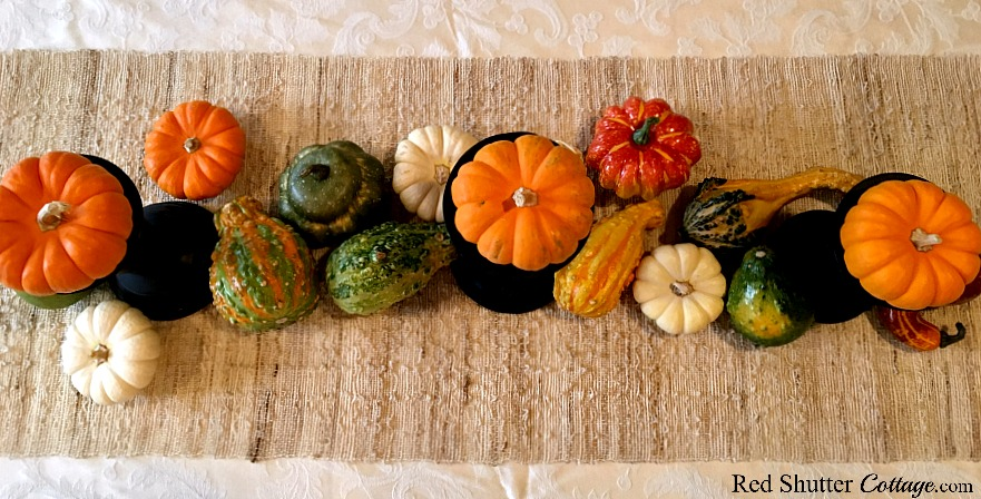 Arranging large harvest fruit for Thanksgiving table tutorial. www.redshuttercottage.com