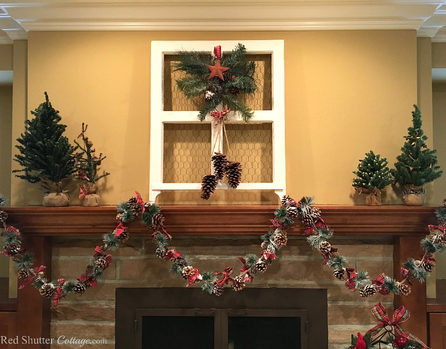 Christmas 2017 mantel with burlap trees and pinecone garland. www.redshuttercottage.com