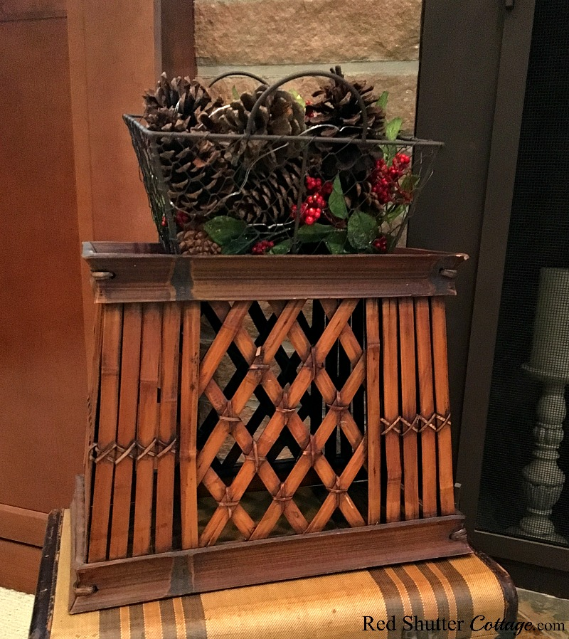 Christmas 2017 basket of pinecones and berries on hearth. www.redshuttercottage.com