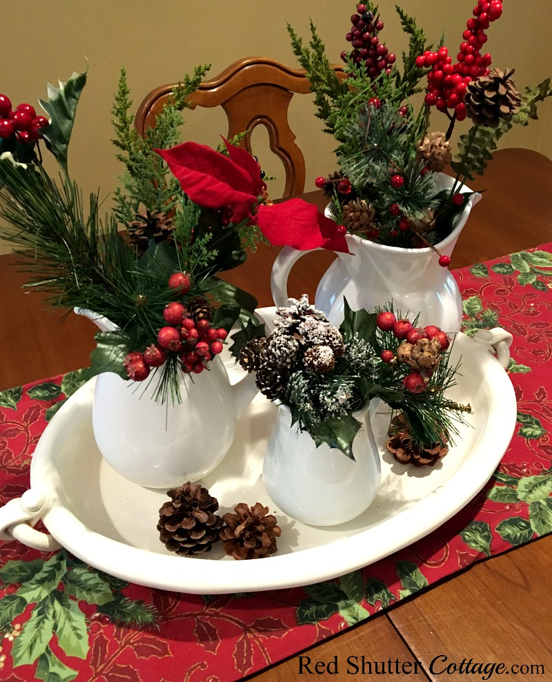 Christmas 2017 dining table vignette with white pitchers and white platter. www.redshuttercottage.com