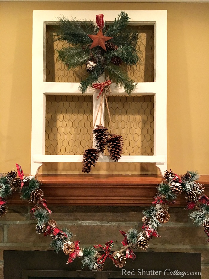 Christmas 2017 mantel with burlap trees and Christmas bough hanging in window. www.redshuttercottage.com