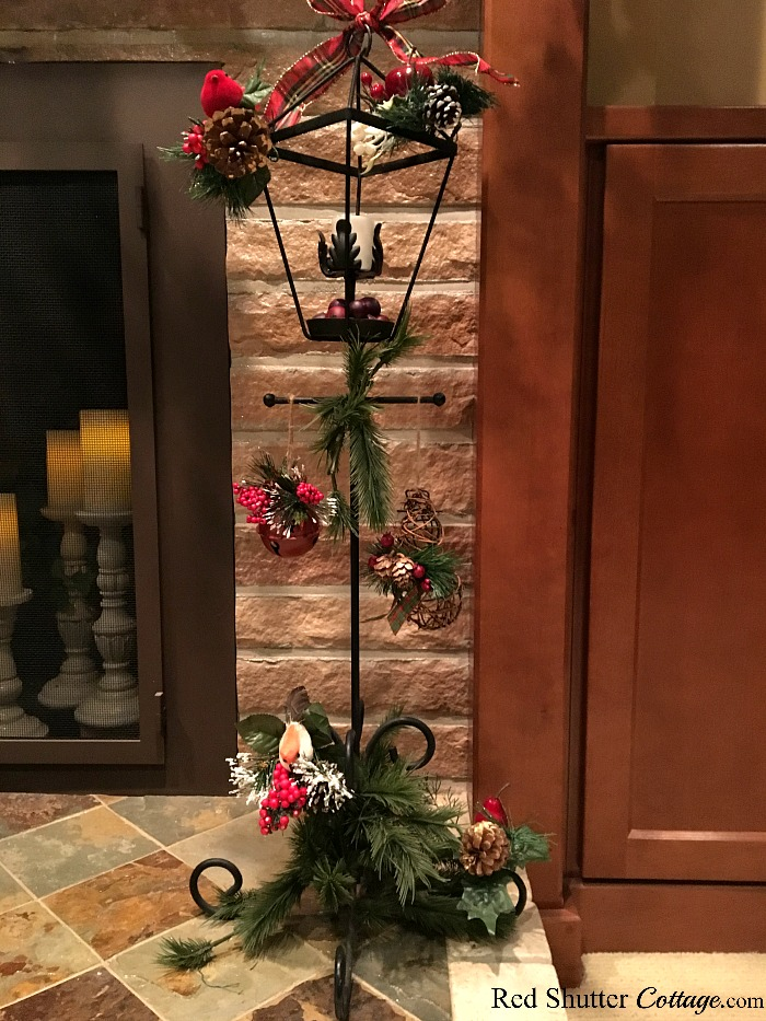 Christmas 2017 wrought iron lamppost with Christmas picks. www.redshuttercottage.com