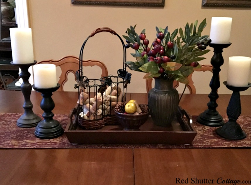 Incorporating tall candle holders in a winter dining table vignette. www.redshuttercottage.com