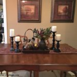 This complete view of a winter dining table vignette, showing the dining table and pictures. www.redshuttercottage.com