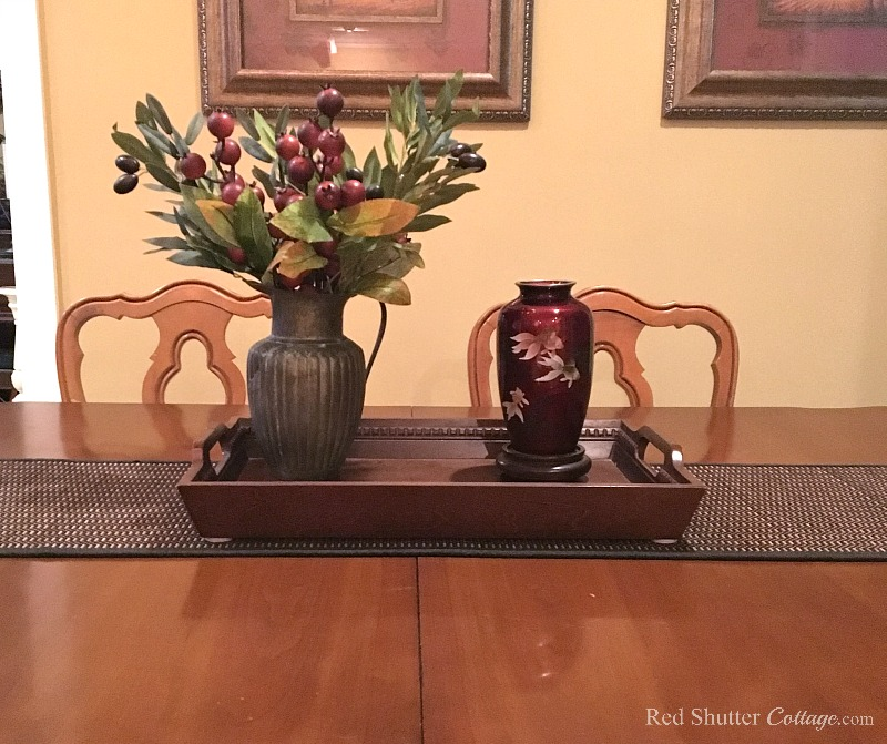 Begin building a winter dining table vignette combining a pewter pitcher and vase. www.redshuttercottage.com