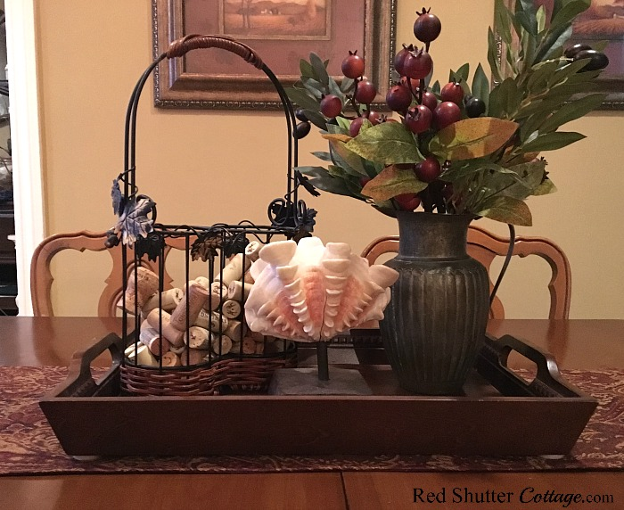 Incorporate natural elements of a shell and winter branches to create a winter dining table vignette. www.redshuttercottage.com