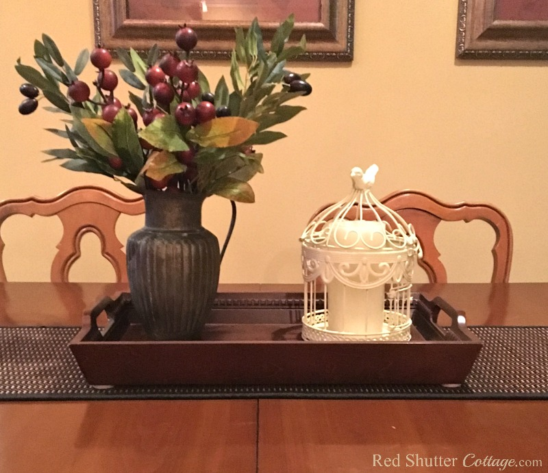 Try a pewter pitcher with white bird cage when building a winter dining table vignette. www.redshuttercottage.com