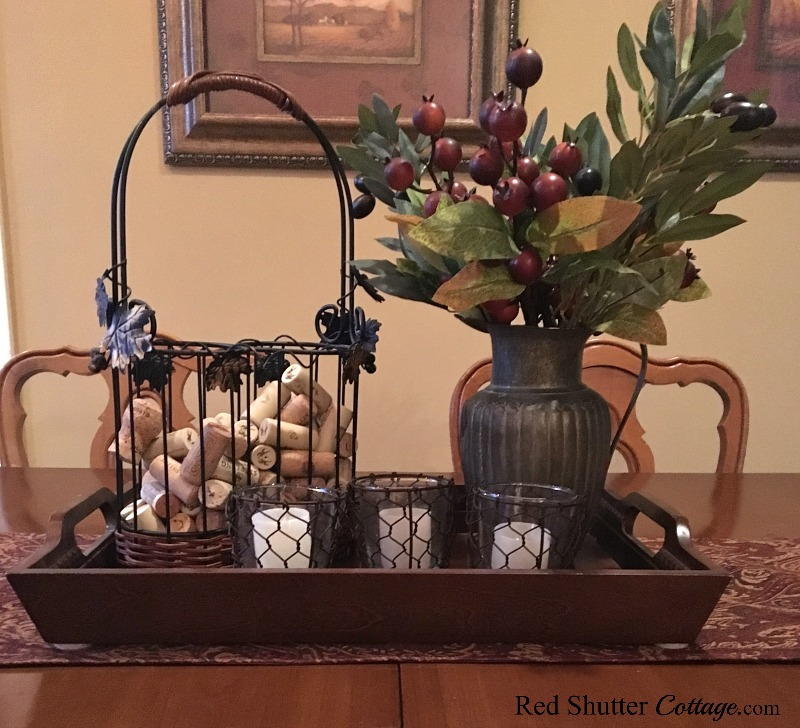 How about using small votive holders along with a wine basket and winter branches to create a winter dining table vignette? www.redshuttercottage.com