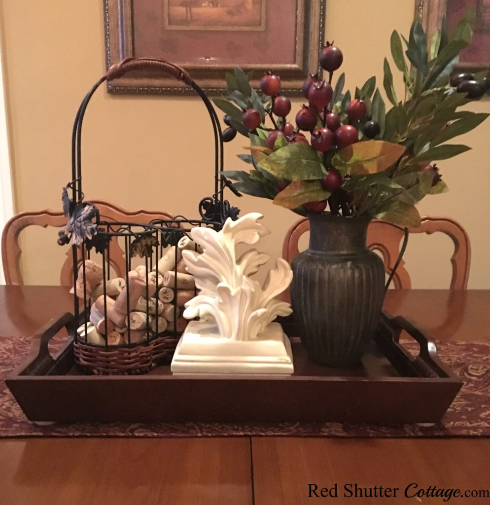Get creative using a sconce and wine basket to create a winter dining table vignette. www.redshuttercottage.com