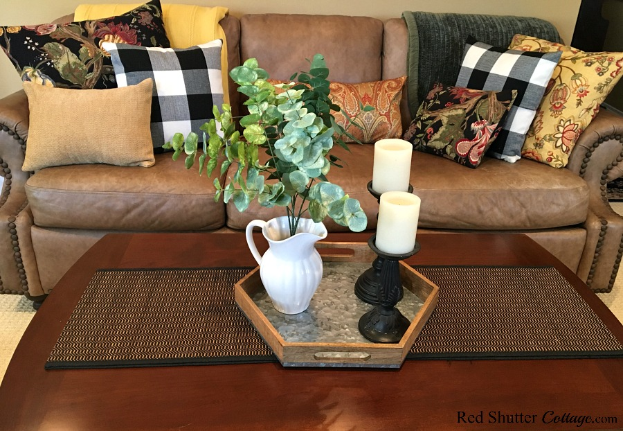 A close up view of our sofa and coffee table as part of our 2018 Winter Living Room. www.redshuttercottage.com