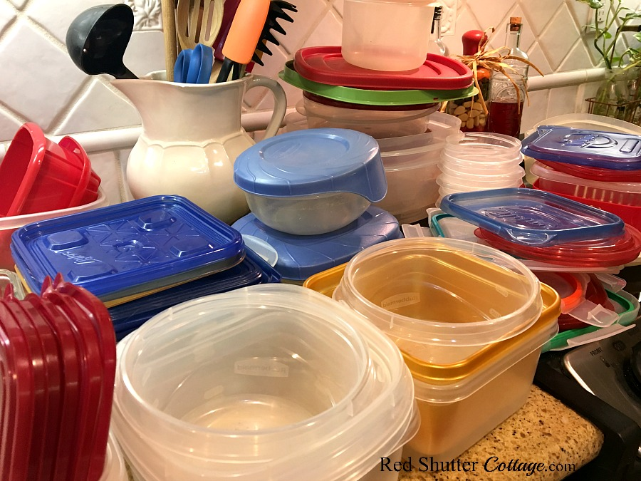 A countertop in the process of how to organize and store containers. www.redshuttercottage.com